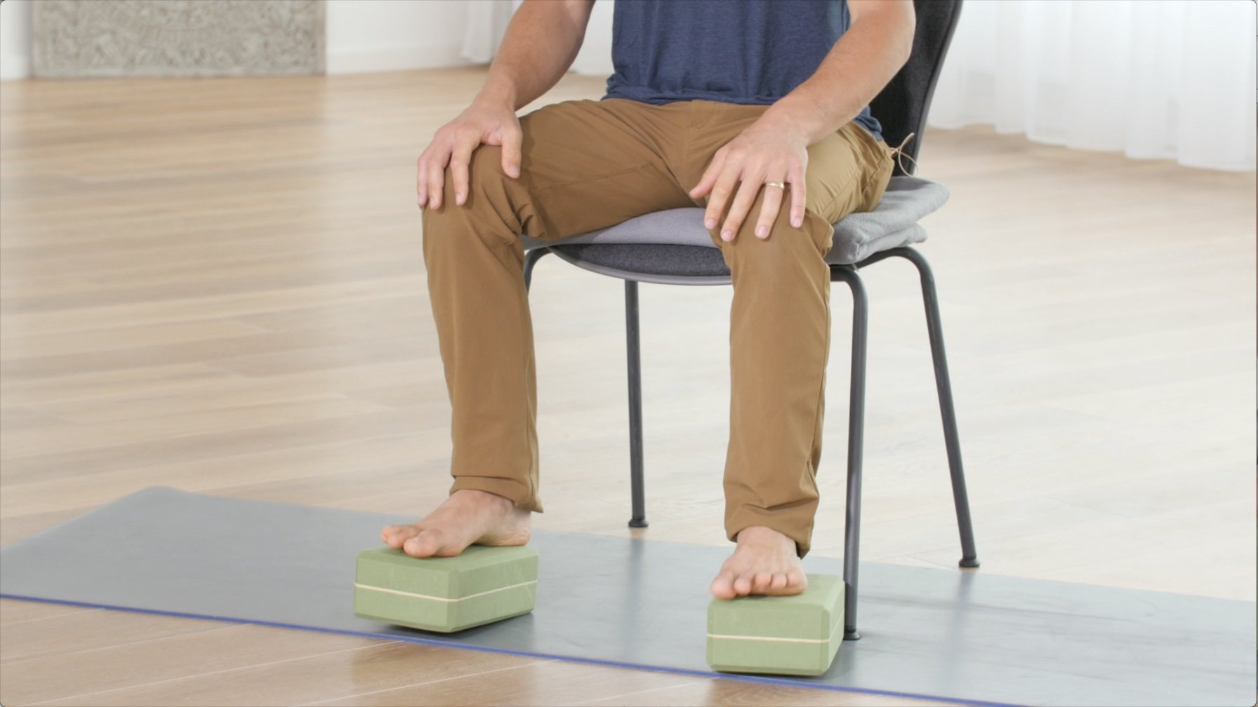 seated meditation posture on chair with props